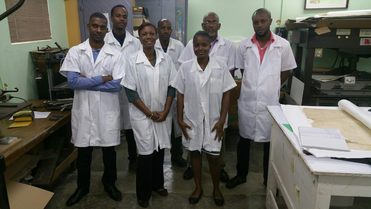 Preservation & Conservation Staff. (back row L-R: Aaron Jones, DonAuthur Campbell, Christopher Valentine, David Mohammed & Gary Johnson. Front row L-R: Nicole Prawl & Sheneka Ward. Image courtesy of The National Library of Jamaica.