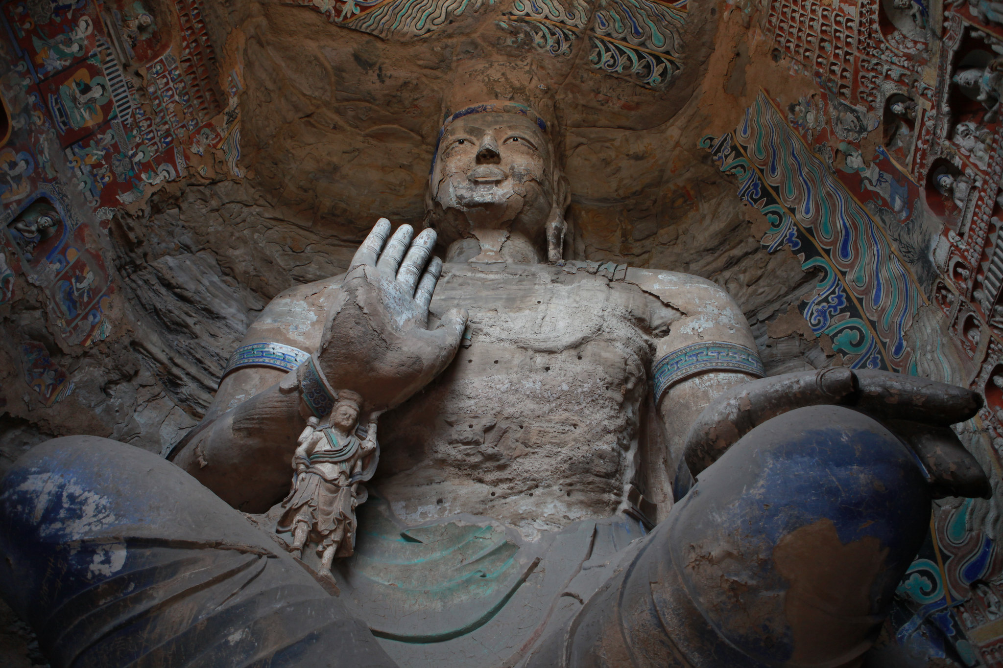 Yungang Caves. Taken on July 31, 2011. Photographer Julie Laurent. Image licensed under CC BY-NC-ND 2.0. Original image location: https://www.flickr.com/photos/julielaurent/6033941621/in/faves-154263974@N03/.
