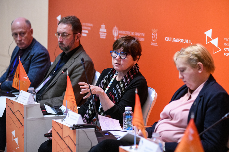 "Speakers from the Cultural Heritage Preservation presentation ""Saving Icon of the Avant-Garde: Survey of Melnikov House as Crucial Stage of its Preservation."" Photographer: Yevgeny Yegorov/TASS Photo. 2018 (original location: https://culturalforum.tassphoto.com/)."