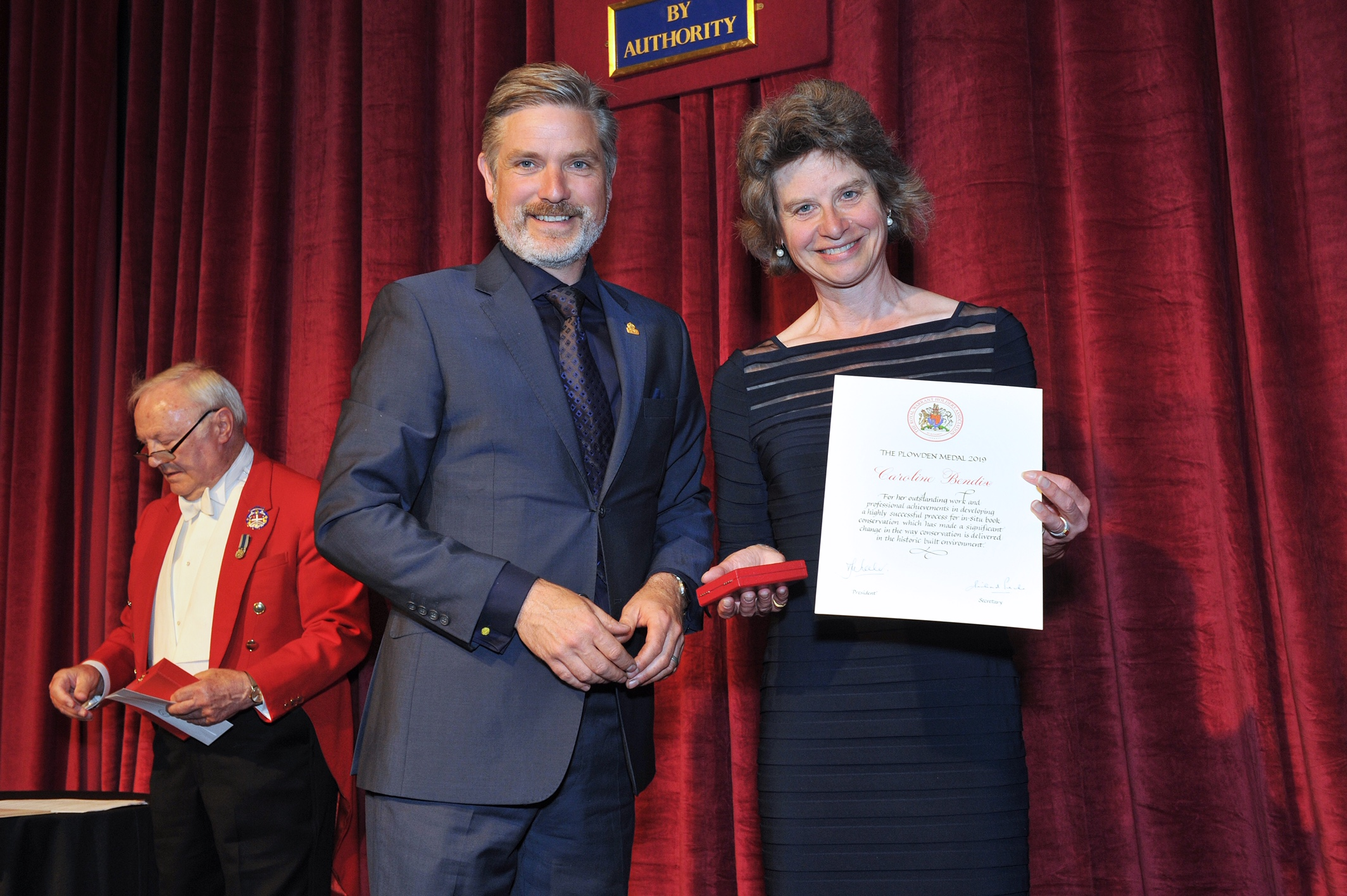 Caroline Bendix receiving her award. Images courtesy of the Royal Warrant Holders association.