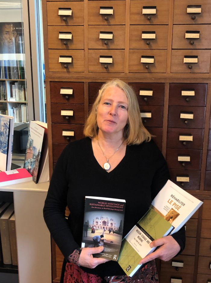 Daniela Sauer holding the three books highlighted in her review. Image courtesy of  ICCROM Library.