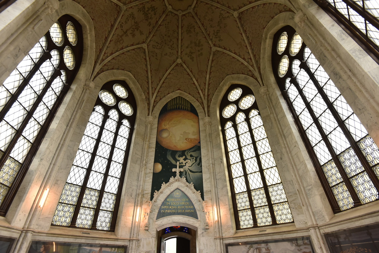 "View to the vestibule. Over the entrance is the Cosmos fresco and a mosaic with text ""Refrigera illos in logo viridi super aqvas refectionis in paradiso deliciarum"".  Image courtesy of the authors"