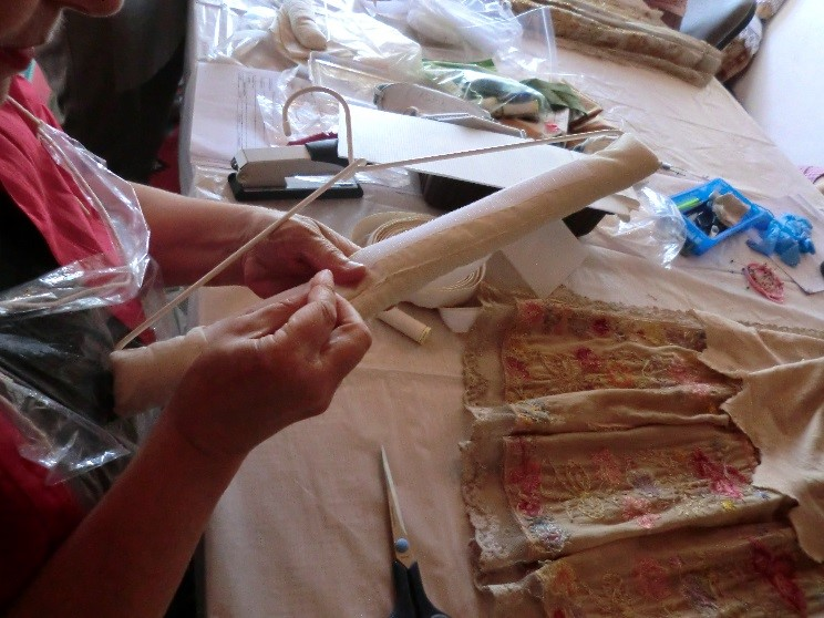Learning sewing skills. Copyright Heritage without Borders