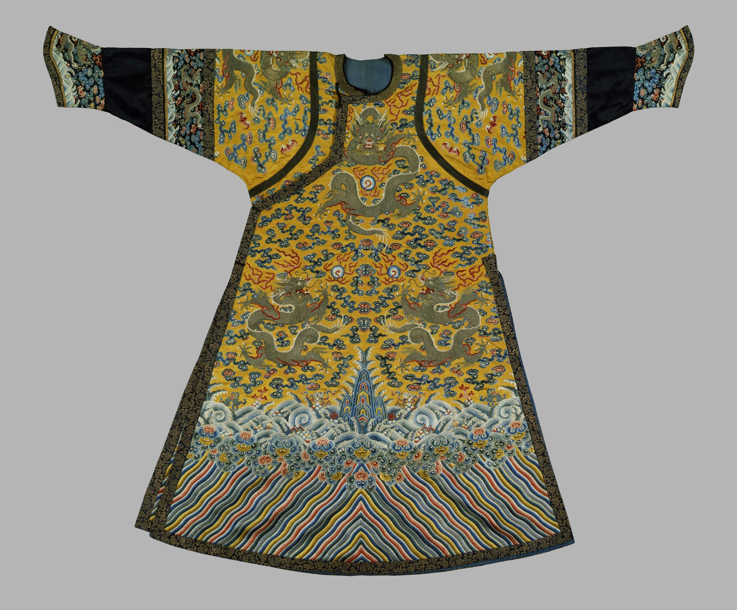 Bright yellow embroidered silk robe with dragons among clouds. Made for an Empress. 1770-1820 (embroidered). © The Victoria & Albert Museum
