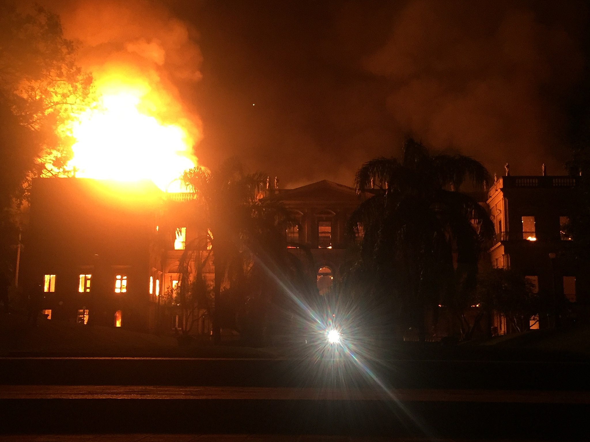Panorama of Brazil's National Museum in flames on 2 September 2018. Incêndio no Museu Nacional, em 2 de setembro de 2018.  Photograph by Felipe Milanez. Licensed under Creative Commons Attribution-Share alike 4.0 International. Original location here.