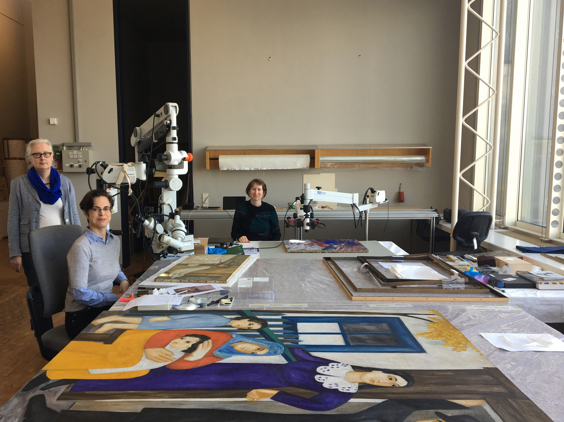 Examination of artworks at Museum Ludwig by Art Analysis & Research. From left to right, Petra Mandt (Conservator of Paintings, Museum Ludwig), Dr Jilleen Nadolny (Principal Investigator, Art Analysis & Research and Project Manager), Verena Franken (Independent researcher and Cologne project coordinator). Absent, Dr Nicholas Eastaugh (Chief Scientist, AA&R).  © Museum Ludwig, 2017. All rights reserved.