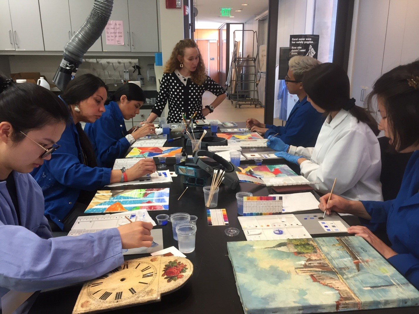 A group of participants trying their hand for the first time at inpainting, supervised by conservator Suzanne Morris. Photo by Ellen Pearlstein.
