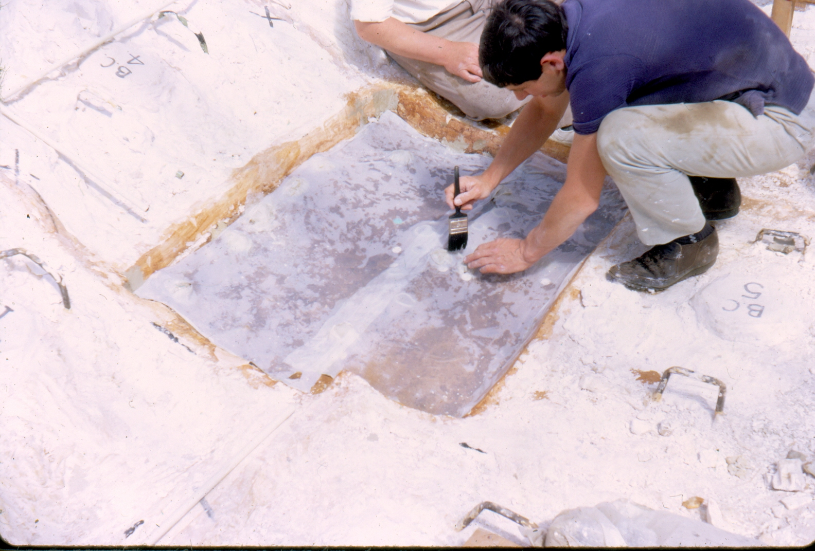 Peter Van Geersdaele preparing the surface of the impression of the ship before pouring the plaster of Paris. Copyright Andrew Oddy