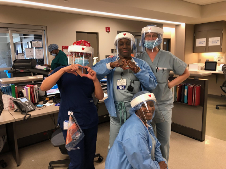 Healthcare professionals in the ICU at DMC Sinai Grace Hospital in Detroit using the face shields made and donated by Whitney Museum of American Art assistant conservator Margo Delidow. Image courtesy of DMC Sinai Grace Hospital, Detroit.