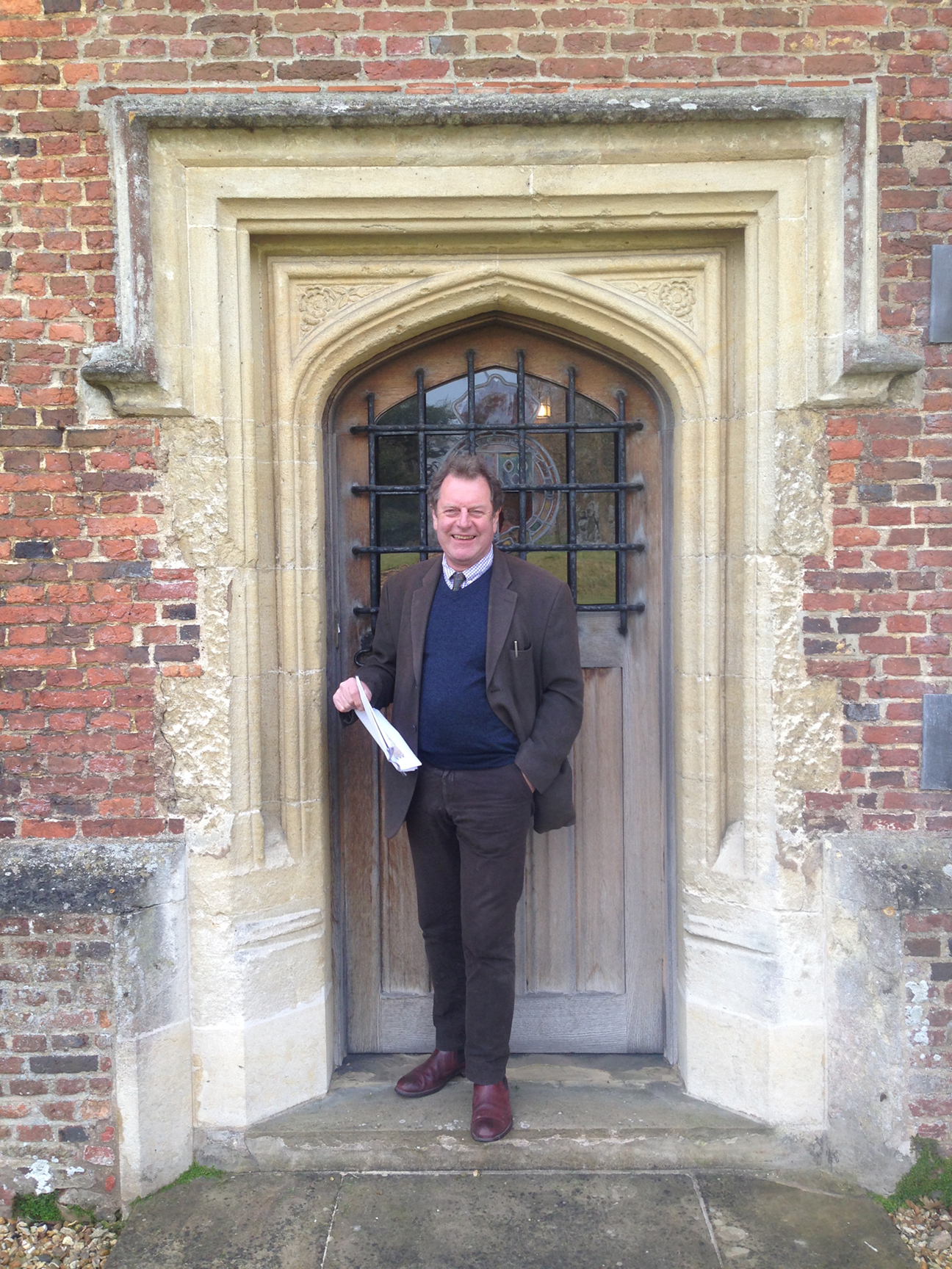 Trevor Proudfoot standing in a historic doorway. Image courtesy of Lewis Proudfoot.