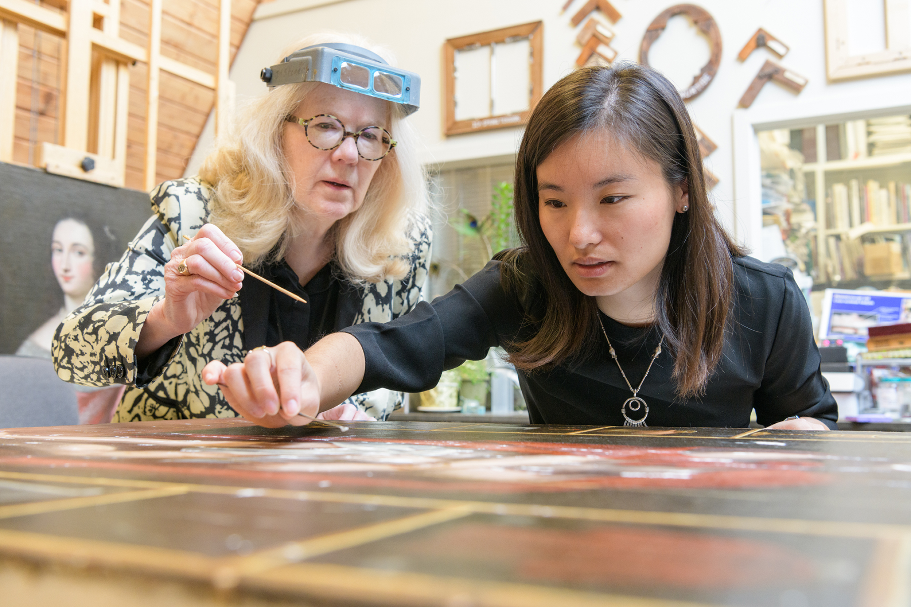 Joyce Hill Stoner with Tracy Liu, paintings conservation major (WUDPAC Class of 2020). Photo credit to Evan Krape © University of Delaware.