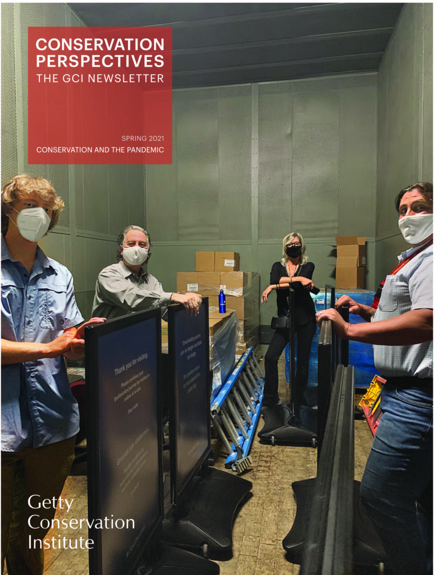 """Cover image of """"Conservation Perspectives"""" Volume 36. Number 1. Spring 2021. Moving signage at the National Museum of American History during the COVID-19 pandemic. Pictured left to right: Langston Swiecki, Pedro Colón, Anthea Hartig, and Stephen Walczak. Photo: Irene Kariampuzha, National Museum of American History."""