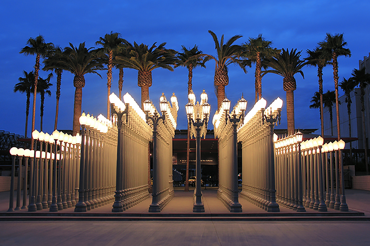 "Chris Burden  Urban Light, 2008  (Two-hundred and two) restored cast iron antique street lamps  320 1/2 x 686 1/2 x 704 1/2 in. (814.07 x 1743.71 x 1789.43 cm)  Los Angeles County Museum of Art, The Gordon Family Foundation's gift to ""Transformation: The LACMA Campaign"" (M.2007.147.1-.202)   © Chris Burden. Photo credit Richard Rownak - rownak.com"