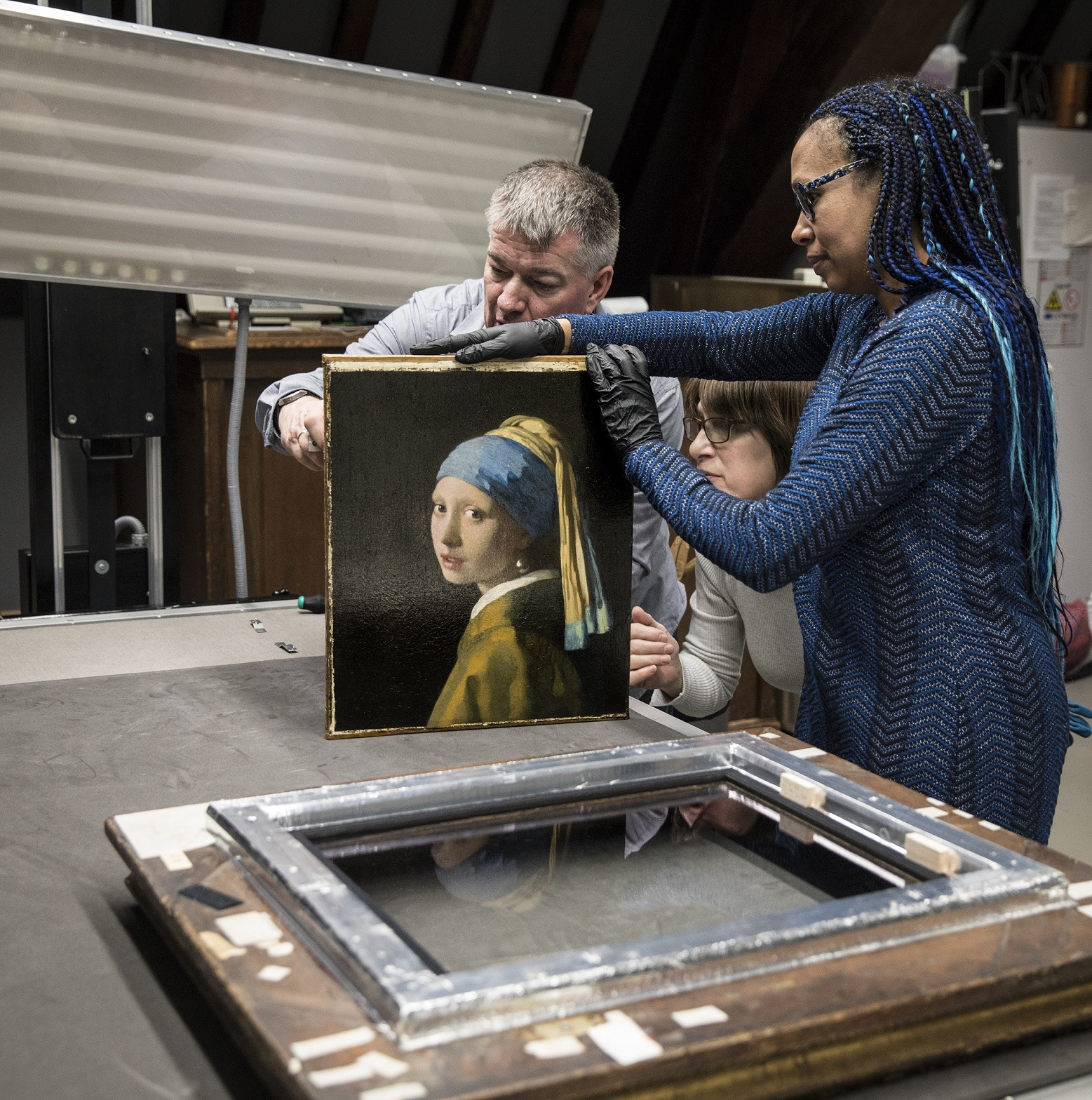 Painting conservator and Head Researcher Abbie Vandivere with the Girl with a Pearl Earring.  The Mauritshuis