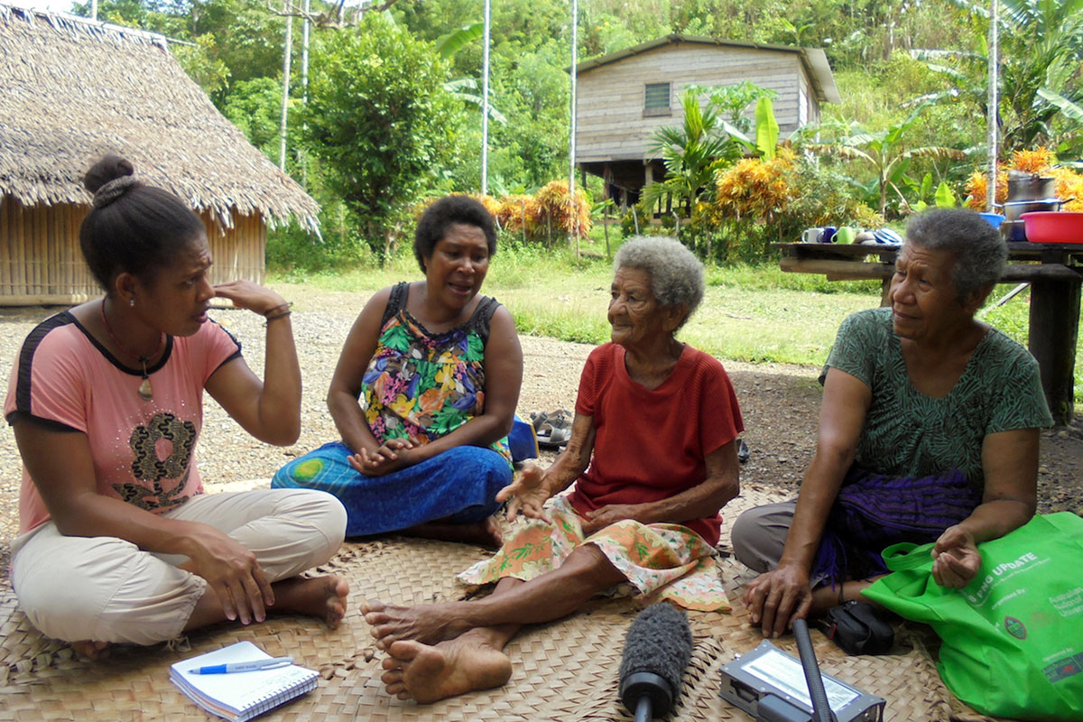 "Elizabeth, Anne, and Baroni being interviewed for ""Voices from the War."" image by Keimelo Gima (Papua New Guinea National Museum and Art Gallery)"