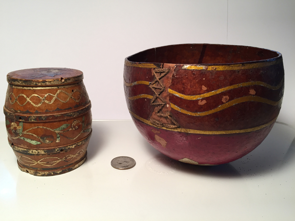 Two modest items from Ecuador, kindly found there and given to me by my Ecuadorian friend, Cristina, decades ago. The smaller one is a carved-wood barrel with one hole (for what, I don't know). The other is a bowl created from a local tree nut. Both are decorated with a material calledbarniz de Pasto(literal translation: Pasto varnish, although I've seen it also translated as Pasto lacquer) that uses a natural resin (usually with colorant's added, but not so inside this bowl, where the layer of oldbarniz