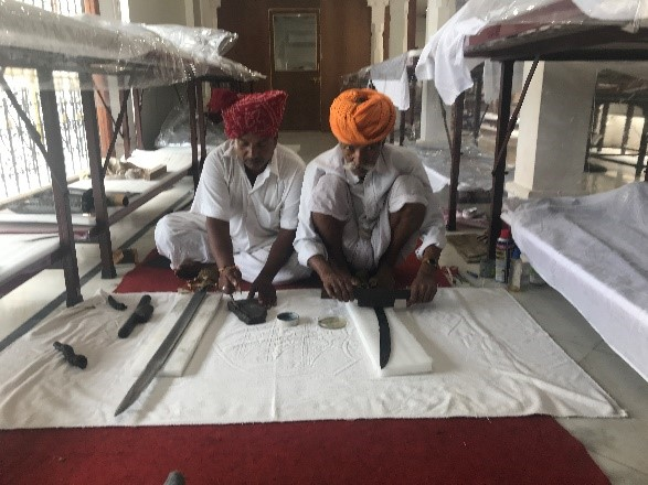 Expert staff preparing swords for display.  Image courtesy of The Maharana of Mewar Charitable Foundation.