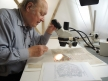 Christopher Clarkson examining a manuscript. Image Copyright Jane Eagan / Winchester Cathedral
