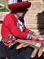 Indigenous Peruvian woman from the Chinchero District in the Andes Mountains demonstrating traditional weaving using locally produced and dyed wool. March 2016. Photograph by Robert R. Oxborrow.