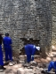 Stonemasons and the Great Zimbabwe conservation team restoring the Conical Tower in the Great Enclosure, 2016. Image by Munyaradzi Elton Sagiya.