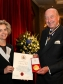 Nancy Bell receives the Plowden Medal from Sir Charlie Mayfield (Photography by Paul Burns) - Royal Warrant Holders Association.