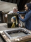 Painting conservator and Head Researcher Abbie Vandivere with the Girl with a Pearl Earring.  The Mauritshuis
