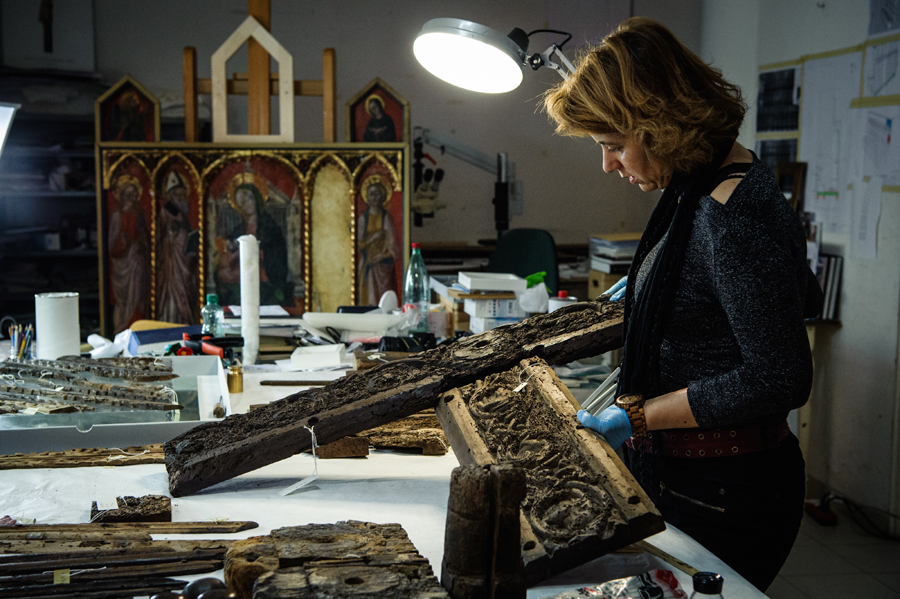 Žana Matulić Bilač examining parts of the door in the Croatian Conservation Institute, Dept of Split workshop, Image courtesy by Tom Dubravec