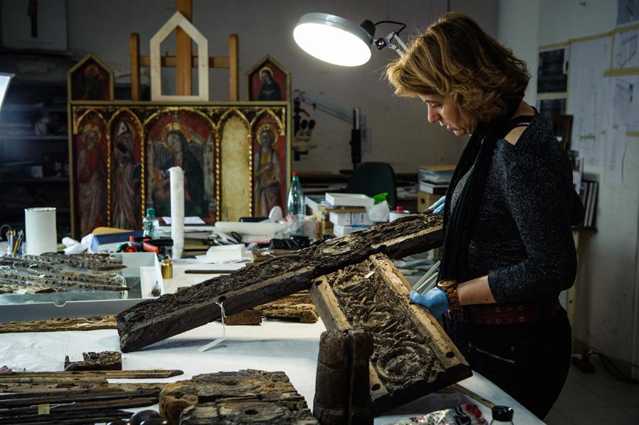 Žana Matulić Bilač examining parts of the door in the Croatian Conservation Institute, Dept of Split workshop, Image courtesy by Tom Dubravec